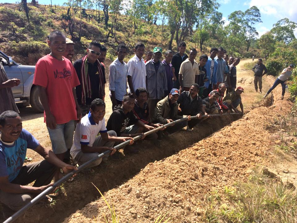 The community proudly showed their work including the trenches where the pipes are laid; the connections between the pipes; and the water pressure at the different distribution points. PHOTO: TLV
